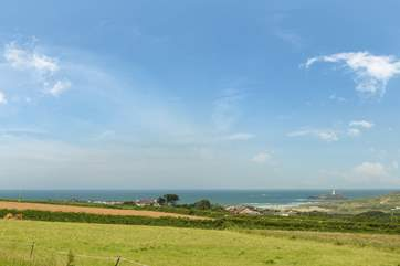 The views across the fields as you come down the driveway to the farmhouse, with Godrevy Lighthouse in the distance.