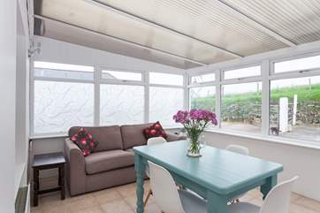 The bright conservatory is a fabulous place to relax in.