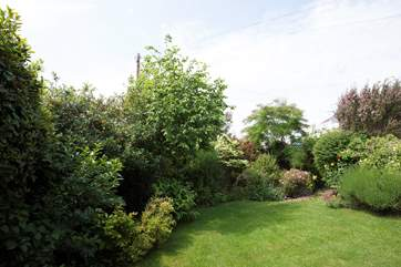 There is an enclosed lawn area to the rear of the house, perfect for children to play in the sunshine.