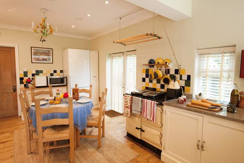 The light dining-area/kitchen is a great space for families to spend time together whilst cooking and eating.