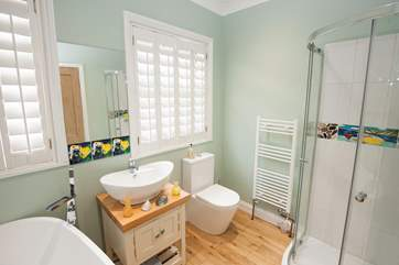 The bathroom on the ground floor has a bath for a lovely soak and shower for a quick morning wake up