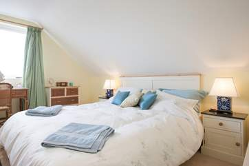 The master bedroom has delightful views across Brading Marshes.