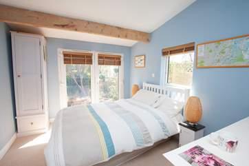 The double bedroom on the ground floor, overlooking the garden benefits from an en suite shower-room