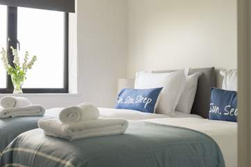 Crisp white linens on comfy quality mattresses make for a good night's sleep.