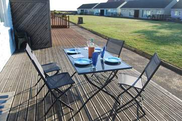 Enjoy breakfast on the decking with views across the communal lawn towards the Sea