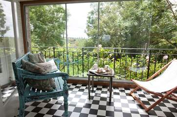 At the back of the house is the mediterranean style sun room, with lovely views to the back garden and fields beyond