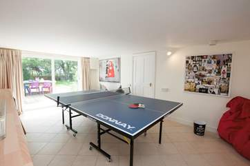 On the lower ground floor is a brillant games room with ping-pong table. Best of three?