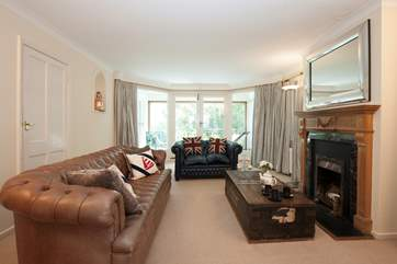 The comfortable and stylish living area with ornamental fireplace is a great place to spend the evenings