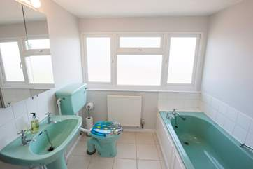 The master bedroom's en suite bathroom is the parents private space for a relaxing soak with some peace and quiet