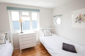 On the first floor is this beautiful twin bedroom, suitable for the adults or the children in your party