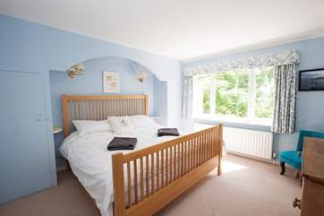 On the ground floor is a double bedroom with views out to the mature back garden