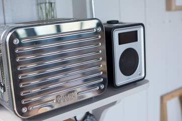 A Dualit toaster and DAB radio are provided.