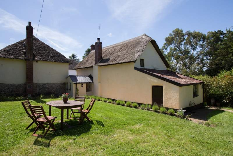 This is the back of the cottage so you can see that the garden is not overlooked at all. There is a small drop from this part of the garden to the garden path at the back of the cottage so do take car