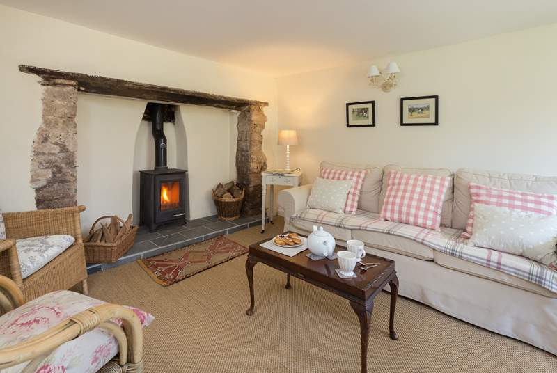 The sitting-room has a wood-burning stove making this a great place to stay all year round.