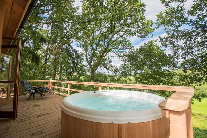 Soak in the hot tub or relax on the loungers taking in the view from the spacious deck.