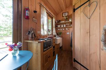 There is a compact but well-equipped kitchen area.