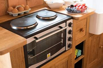 A mini cooker with hob is provied as your cooking appliance.