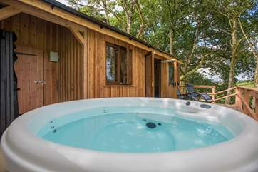 Complete with a bubbling hot tub to enjoy those views too.