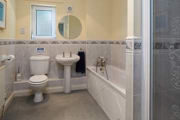 Family bathroom on the first floor comprises of a bath and a shower cubicle.