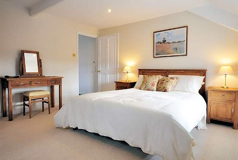 The master bedroom, exceptionally spacious with a fabulous king-size bed.