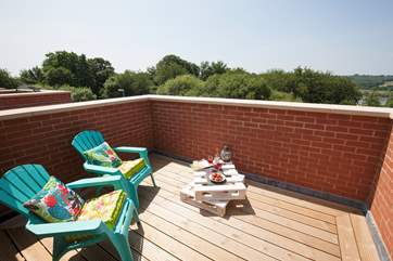 The stunning roof terrace is the perfect reatreat to relax and have a glass of wine once the children have gone to bed