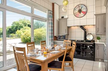 The stylish kitchen/dining-room with a fabulous five oven range cooker.