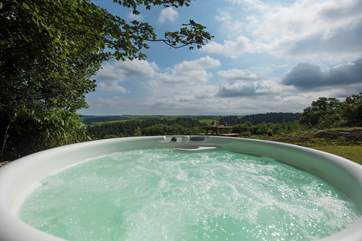 There is even a bubbling hot tub with spectacular far reaching views across the valley and countryside beyond.