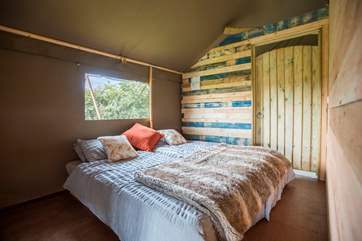 The twin beds can be pushed together, as shown, or moved apart. This bedroom also has a door through to the shower-room.