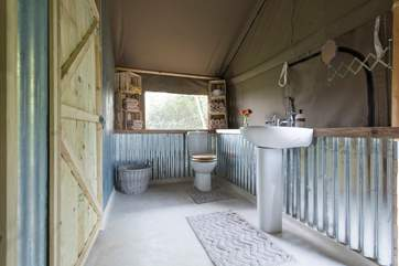 The shower-room is at the back of the tent and can be accessed from both the double and twin bedrooms.
