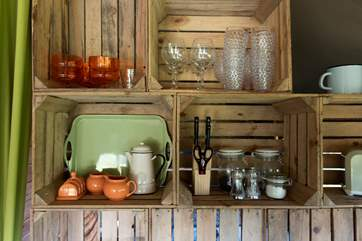 The quirky kitchen shelves have been creating using apple crates.