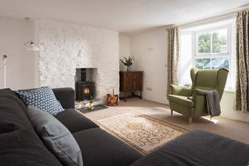 The sitting-room has a lovely little wood-burner, perfect for winter stays.