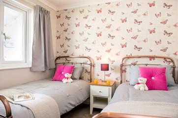 Bedroom 4 has delightful copper-effect bedsteads.