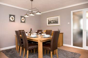The dining-area leads off from the kitchen and there is plenty of room for all to gather at meal times.