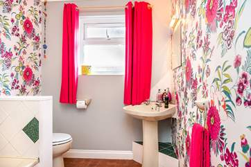 The family bathroom has a fitted shower and a bath.
