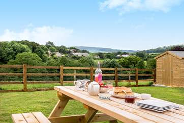 The garden is south-facing, perfect for al fresco dining.