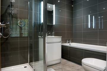 Bedroom 1 has a modern en suite with a bath and separate shower.