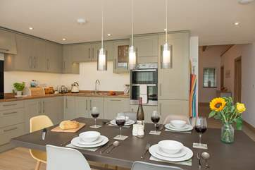 Although open plan, the kitchen/dining area sits separate to the sitting-area givng the best of both worlds.