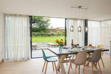 The wrap around windows make this room incredibly light and of course give easy access to the garden.