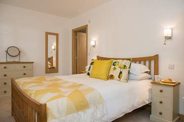 Bedroom 1 with its king-size double bed has been decorated in beautiful soft, restful colours.