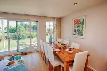 Seating 8, this fabulous dining room table overlooks the river, a beautiful setting for a family meal