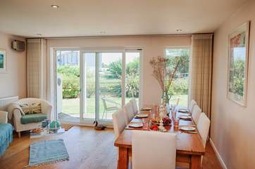 The dining-room has sliding doors to the patio, open them up on a summers day and let the fresh air in