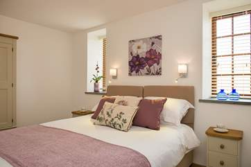 Both bedrooms have super comfy mattresses, crisp white linens, soft throws and plump cushions!
