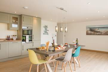 Although open plan the kitchen and dining area are separate from the sitting-area givng you the best of both worlds.