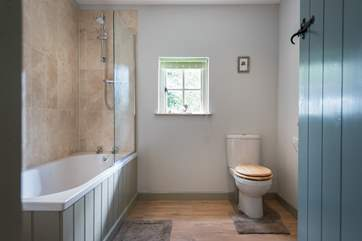 The family bathroom has both a bath and fitted shower above.