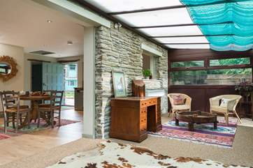 An open archway leads from the living-room to the big conservatory which overlooks the private garden.