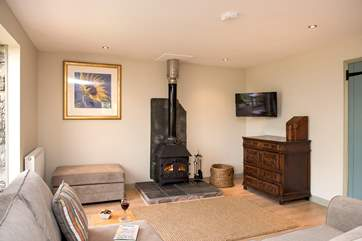 The wood-burner is perfect for cosy film nights snuggled up on the corner sofa.