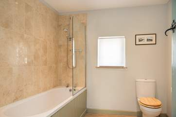 Enjoy a soothing holiday soak in the family bathroom but of course there is also a shower if you have a little less time.