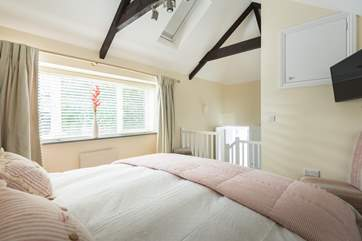 Bedroom 1 is accessed via a short flight of stairs.