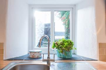 The kitchen sink looks out over a little enclosed courtyard.