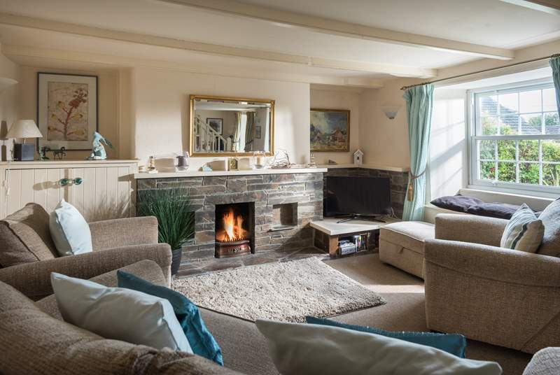 An open fire in the sitting/dining-room.